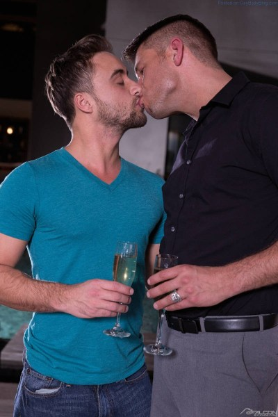 two handsome men kissing
