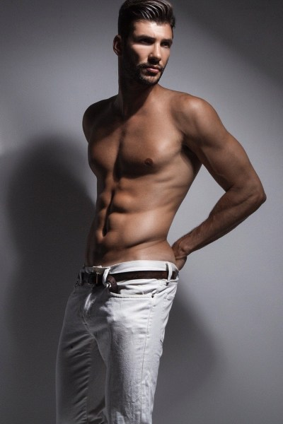 handsome male model Artur Dainese shirtless in white jeans