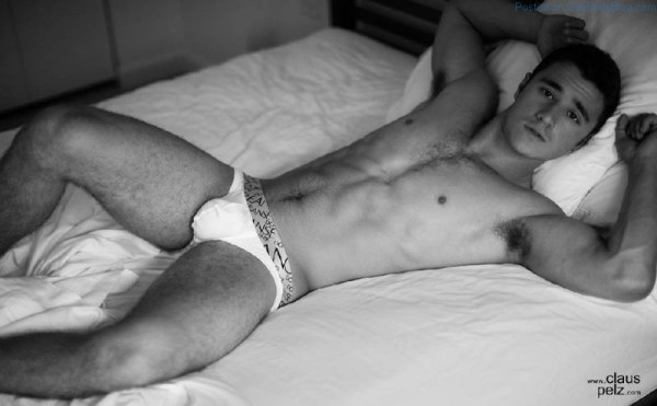 Lance Syverson lays on a bed in white underwear