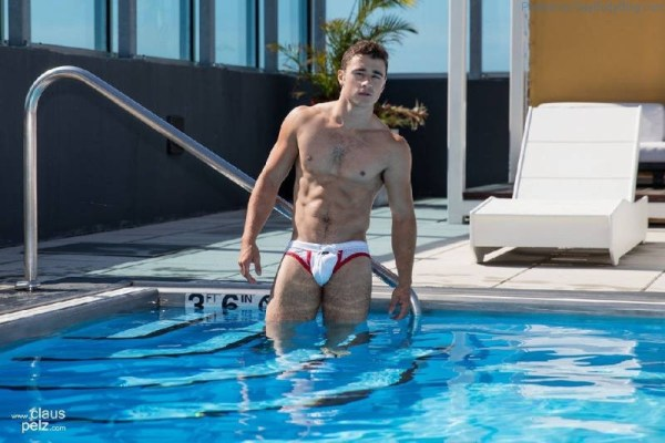 Lance Syverson climbs into a pool in his bulging trunks