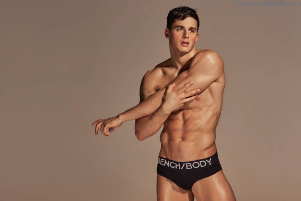 sexy male model Pietro Boselli stretching in just black underwear