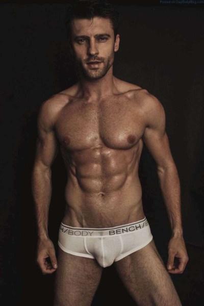 Gorgeous male model Vinicius Piccolo bulging in white underwear