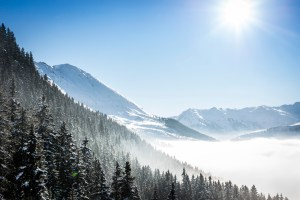 Snow covered winter mountains with fog in the valley
