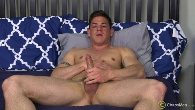 muscle daddy jerking off on a bed