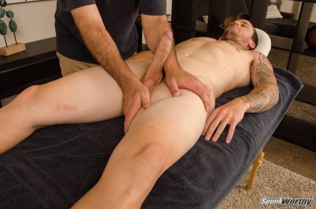 Naked straight guy with a big erectio being massaged by another man in a happy ending