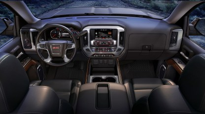 2016 GMC Sierra SLT Interior front dash view from the rear seats