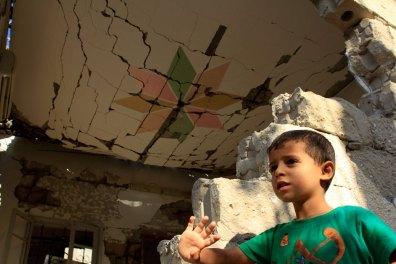 Boy under a broken roof