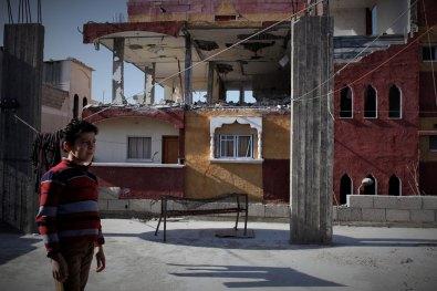 Boy among colored ruin