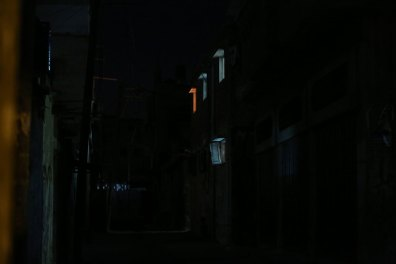 Alley at night with lit windows