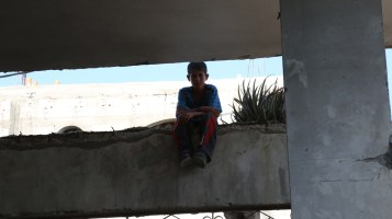 Boy seated on the ledge