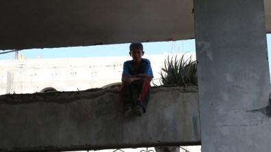Boy seated on the ledge