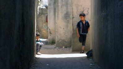 Boys in an alley in Al Shatie refugee camp