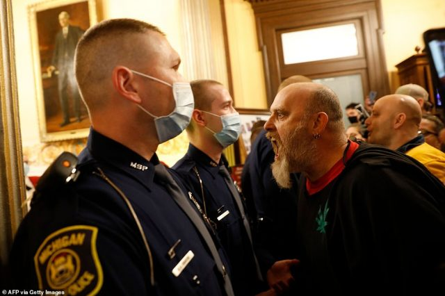 27855052-8275171-Protesters_tried_to_enter_the_Michigan_House_of_Representatives_-a-111_1588283688548-640x426