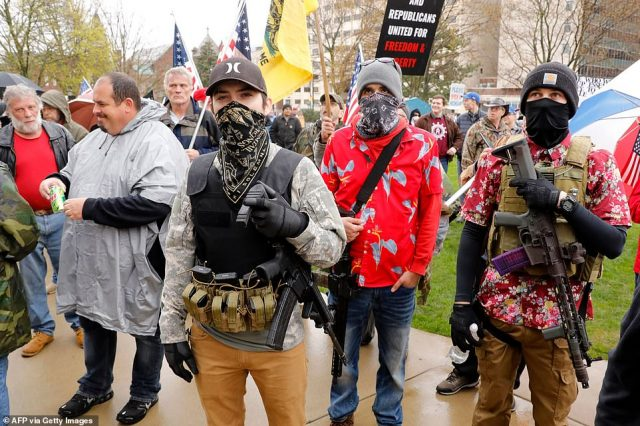 27855264-8275171-Armed_protesters_provide_security_as_demonstrators_take_part_in_-a-121_1588283688804-640x426