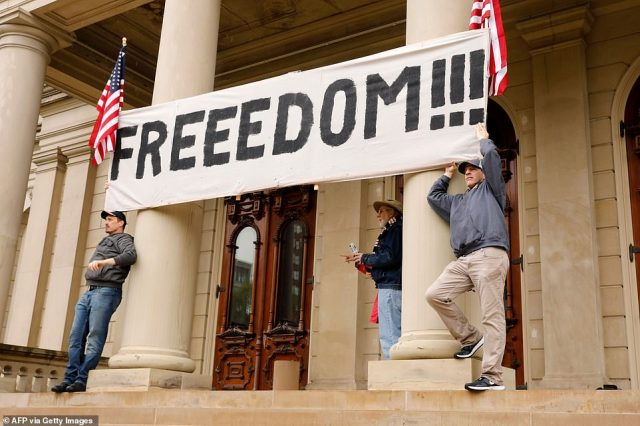 27856076-8275171-Demonstrators_hold_a_banner_with_the_word_freedom_during_Thursda-a-127_1588283688924-640x426