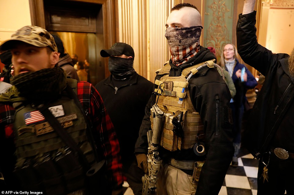 27856086-8275171-Armed_men_are_seen_inside_the_Michigan_State_Capitol_after_they_-a-110_1588283688547