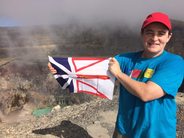 Dr. Loeffler stands at the top of Santa Ana, El Salvador's highest volcano.