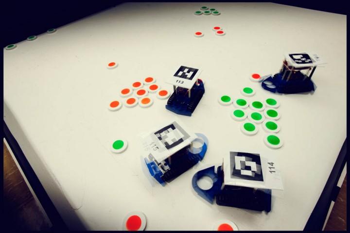 Robots sort pucks in Dr. Andrew Vardy's BOTS lab.
