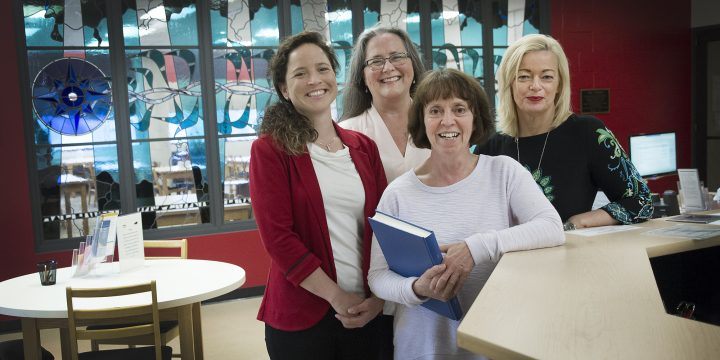 From left are Jennifer Guy, Dr. Sandra MacDonald, Dr. April Manuel and Linda White in the Centre for Newfoundland Studies in the Queen Elizabeth II Library.