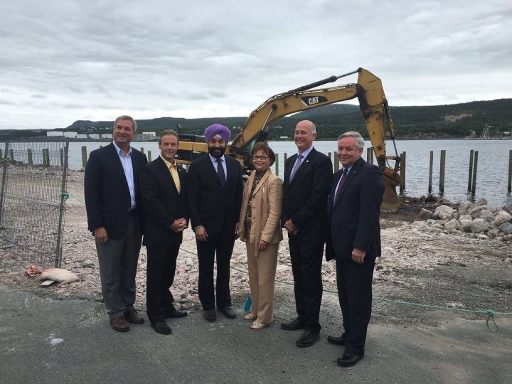 From left are Gerry Byrne, Gary Goobie, Navdeep Bains, Judy Foote, Ken MacDonald and Glenn Blackwood at the Holyrood Marine Base.