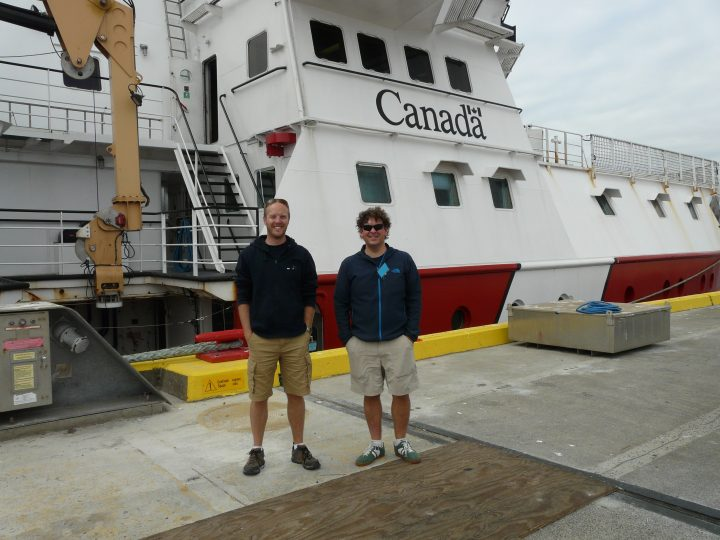 From left are Drs. John Jamieson and Stephen Piercey in front of the Canadian Coast Guard Ship John P. Tully.