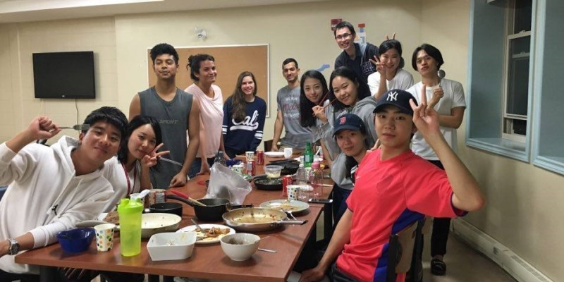 Students in the Global Living Village sharing a meal