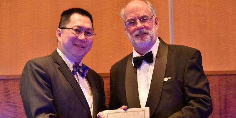 From left are Dr. Lye and and Dr. Richard Bathurst, president, EIC.