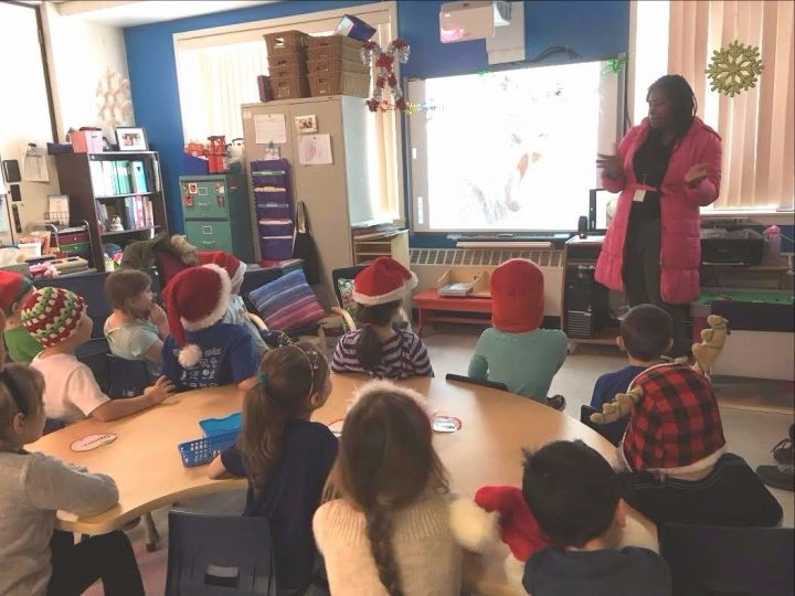 Joyce Mojimbo presents to the schoolchildren about her home country, Cameroon.