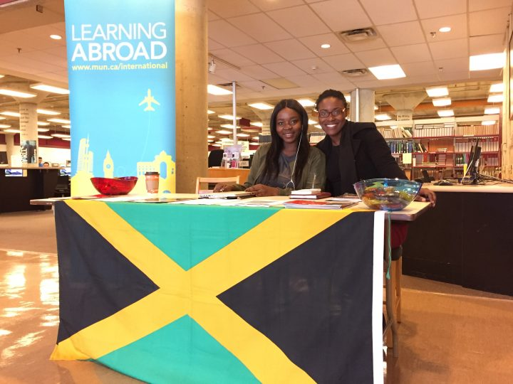 From left, Memorial student Sylvia Unimna and University of the West Indies student Shantal Cover at a travel abroad popup information booth at the QEII Library.