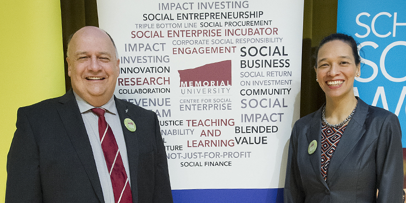 Dr. Gary Kachanoski and Nicole Helwig pose in front of banners at the launch of the Centre for Social Enterprise.s launch on May 25.