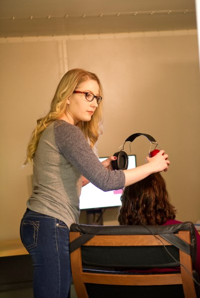 Bethany Power prepares a participant for a hearing test.