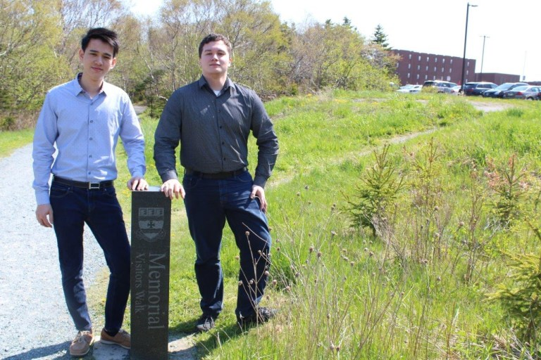 Shawn (Meishang) Chen and Diego Alejandro walk the trail around Lond Pond