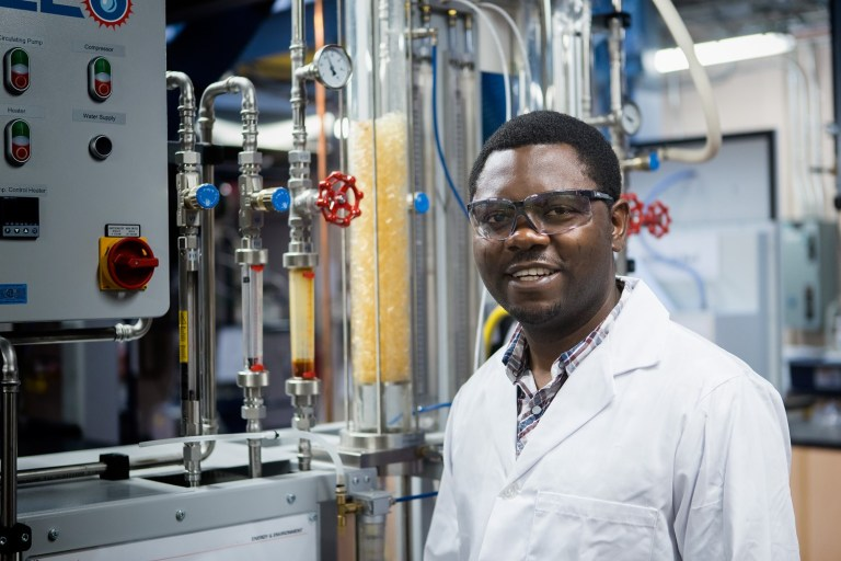 As a teaching assistant, Peter Ogban guides students through experiments in thermal engineering labs.