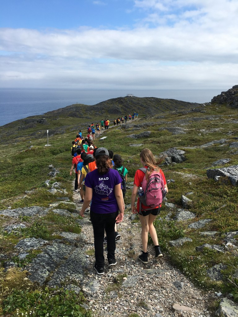 SHAD Memorial students walk the Lion's Den Trail on Fogo Island in summer 2016.
