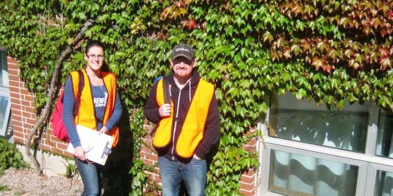 From left, biology students Jasmine Pinksen and Nathaniel Bartlett participated in bird-window mortality on campus.