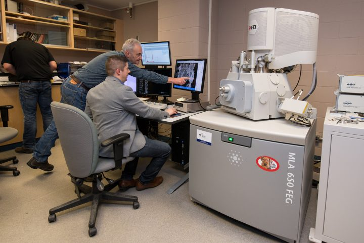 From left Drs. Derek Wilton and David Grant in the scanning electron microscope-mineral liberation analyzers facility.