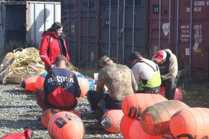 Commercial fishermen in Dutch Harbor, Alaska, take surveys designed to evaluate their perceptions of risk as well as their opinion on personal floatation devices. NIOSH Researcher Samantha Case (left) will be presenting on factors for crewmember survival in Alaska vessel sinkings as well as NIOSH's work in tracking injuries in the U.S. commercial fishing sector.