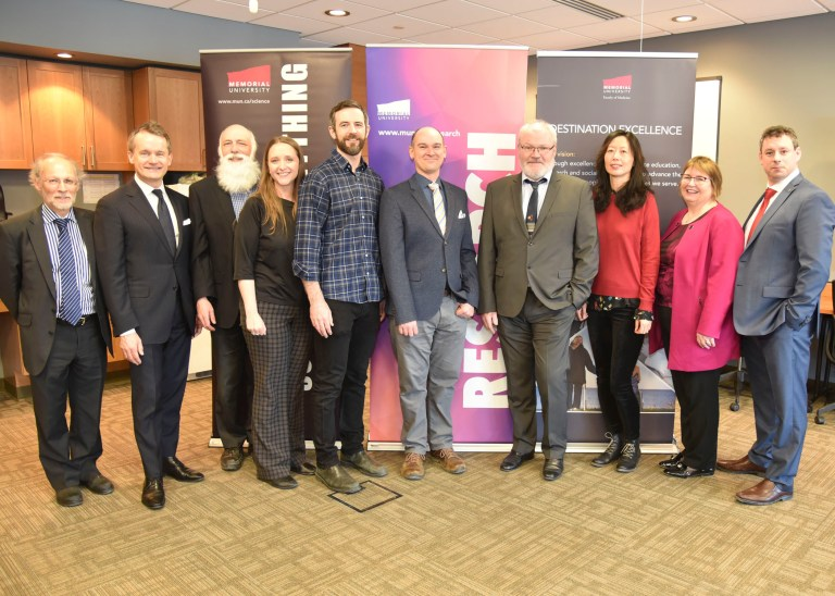From left are Dr. Neil Bose, Seamus O'Regan, Dr. Len Zedel, Dr. Sheila Garland, Dr. Matthew Parsons, Dr. Graham Fraser, Dr. Bruno Stuyvers, Dr. Qi Yuan, Dr. Margaret Steele and Nick Whalen.