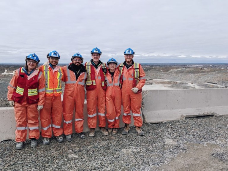 Group of students in safety clothing