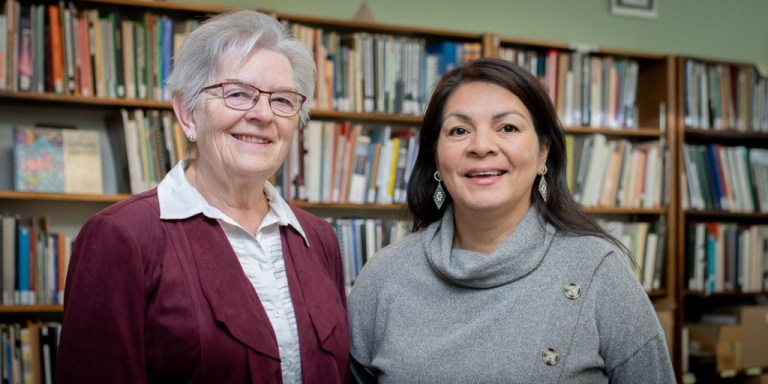 From left are Dr. Marguerite MacKenzie and Kanani Penashue Davis.