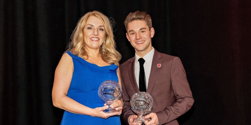 Pictured are Anne Whelan and Matthew Raske, holding humanitarian awards from the Red Cross of Newfoundland and Labrador.