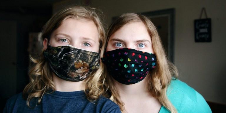 Family members wearing homemade masks