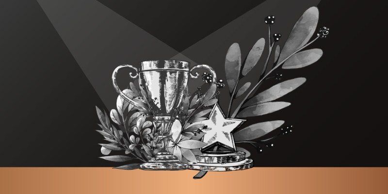 A design with a black background featuring a trophy, star, leaves and a thick golden-coloured line at the bottom.