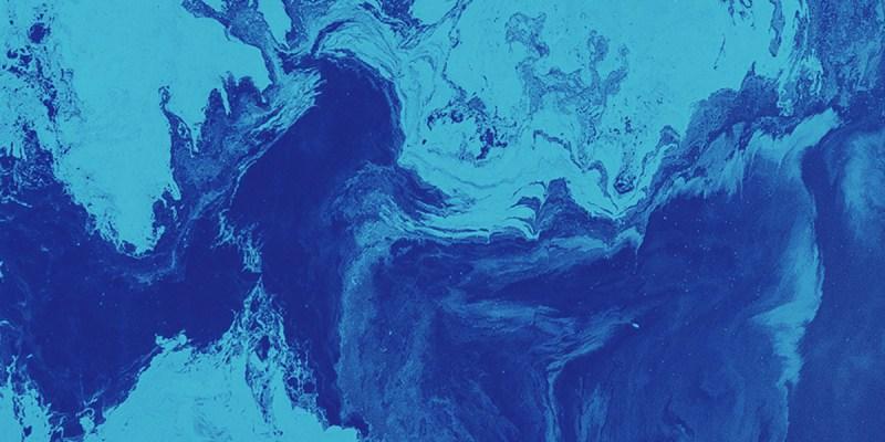 A design featuring dark and light coloured blue swirls.