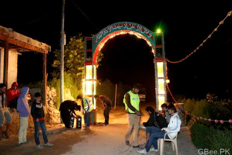 A lit-gate is installed on a road in Karimabad, Hunza