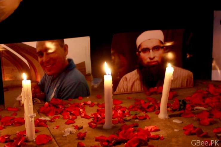 Pictures of deceased passengers and crew were displayed at candlelight vigil in memory of crashed PK-661 flight.