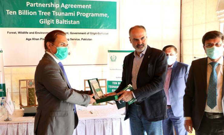 Mr.Nawab Ali Khan, CEO, AKAH,P is presenting a token of appreciation and partnership to Mr. Shah Zaman, Secretary, Forest and Wildlife, Department of Gilgit-Baltistan