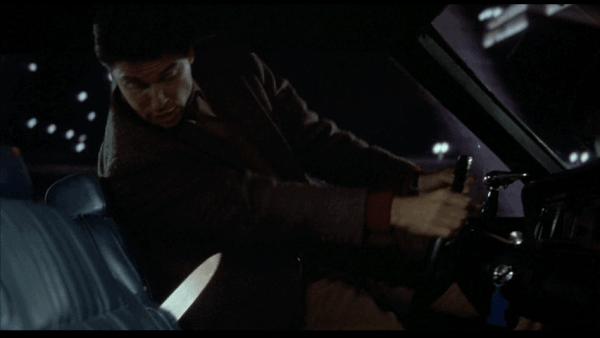 Childs-Play-1988-Norris-Chris-Sarandon-knife