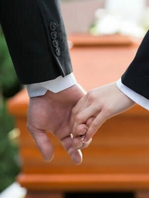 Holding hands at funeral