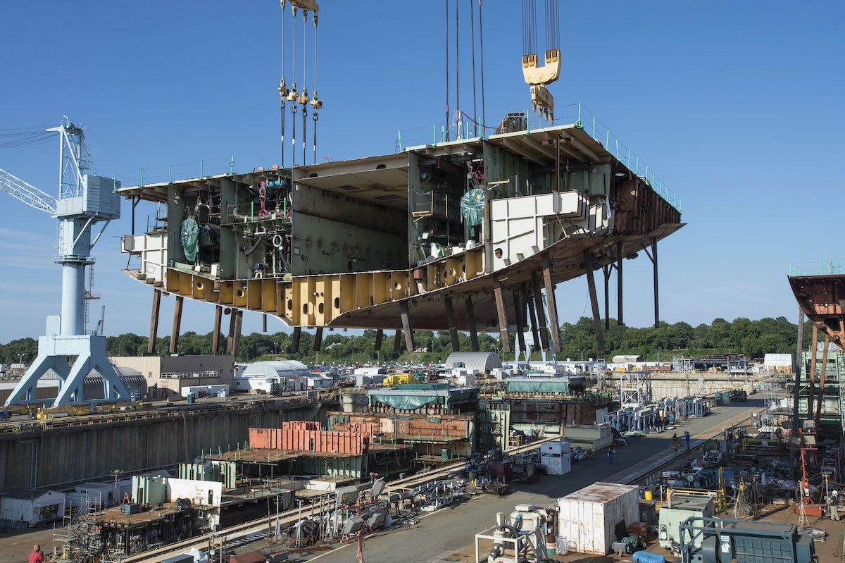A large section of the future John F. Kennedy (CVN 79) is lifted into place at Huntington Ingalls. Photo credit: Huntington Ingalls
